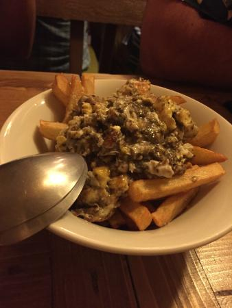 Scrambled eggs with truffles over fries