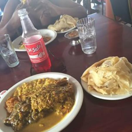 Wings Roti Shop : Curry chicken with curry mango and buss-up-shut