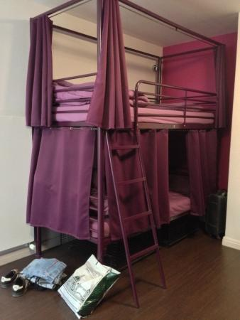 Double Decker Beds With Privacy Curtains Near Windows