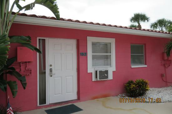Tropical Breeze Resort: room door and seating area