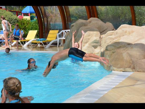 La Grainetiere Camping : Enjoying the heated pool.
