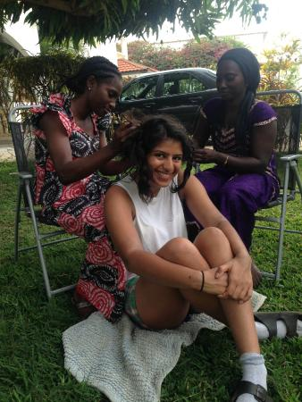Kaz getting her hair braided at Devon Lodge, arranged by Ebu and Patricia