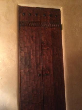 Antigua Inn: Looks like a closet, but this is your door to the bathroom in the Tapestry Room