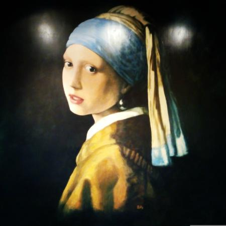 "Hotel Johannes Vermeer: ""Girl with pearl earring"" - famous picture of Johannes Vermeer painted on the wall of the restau"