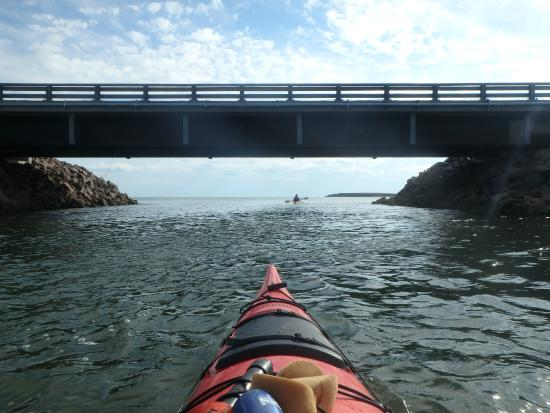 By The Sea Kayaking : tide coming in under the bridge into the river