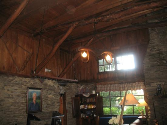 The Cataloochee Ranch: Beams of cieling left of fireplace