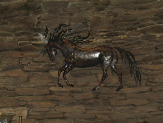 The Cataloochee Ranch: Brass horse on the fireplace