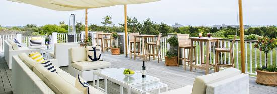 Enjoy our outdoor deck with view of South Beach at The Dunes
