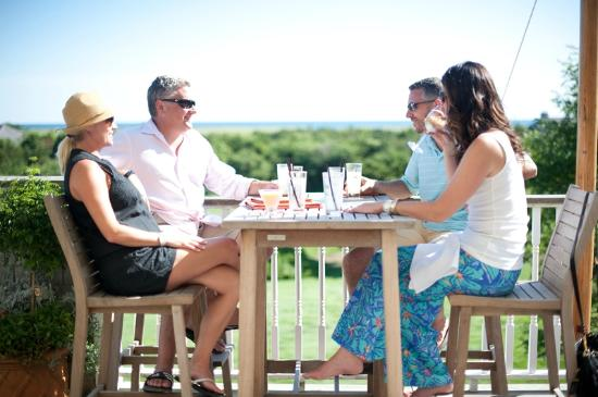 Enjoy a meal or drink on our outdoor deck at The Dunes - complete with a South Beach view.