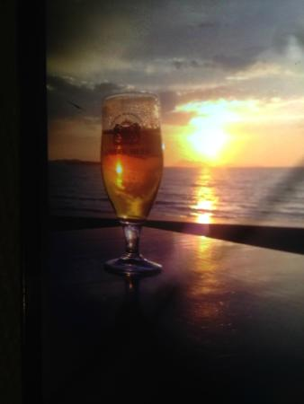 Agios Stefanos, Yunanistan: a sanstef sunset and a corfu beer HEAVEN