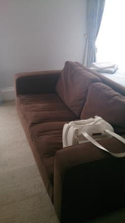 Abbots: large sofa bottom of bed