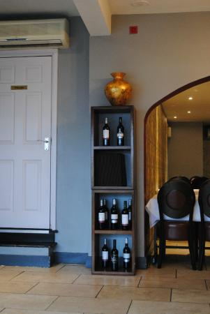 Vasai Fine Indian Dining: Wine cabinet in the foyer