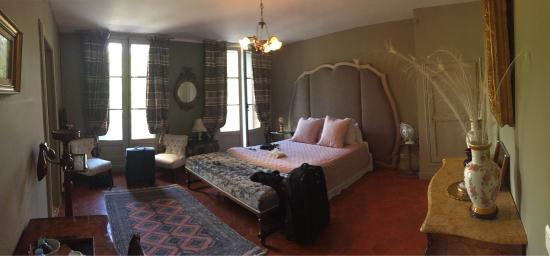 Chateau de Murviel : Extremely luxurious bedroom. Step through the shuttered windows onto the balcony