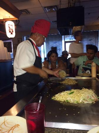 Fuji Japanese Steakhouse: Chef serving fried rice, and cooking noodles