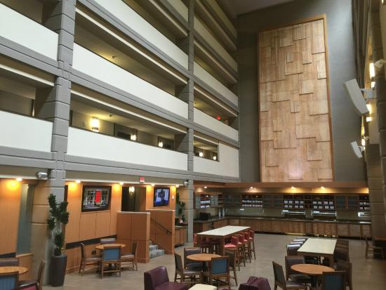hotel dining room and tv area picture of hyatt place. Black Bedroom Furniture Sets. Home Design Ideas