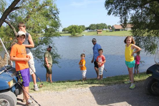 Beaumont Ranch: Some Camp Cullin dads and kids fishing at the paddle boat pond!