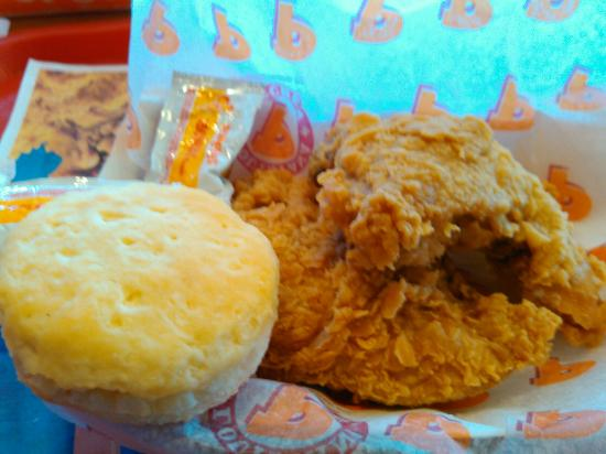 Popeyes Louisiana Kitchen Food fish dinner with dirty rice, and two piece chicken meal at
