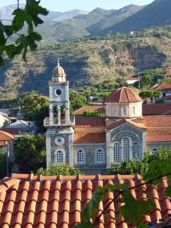 View of the central church in Exochori from balcony of One Foot on the Mountain