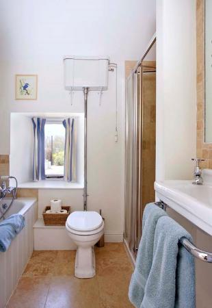 Donnington, UK: Bathroom at Granary next to Wren House with shower and bath, travetine tiling and underfloor hea