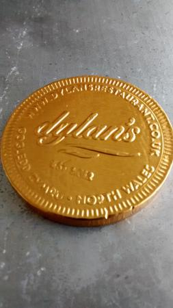 Chocolate coin served with hot chocolate