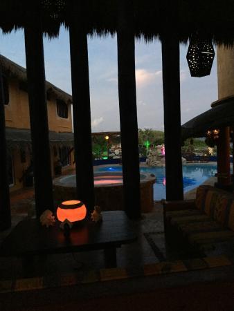 Villa La Bella: Open-air seating area in evening