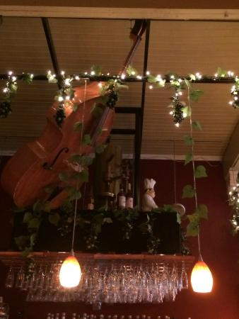 Diane's Restaurant & Bakery: Double bass hanging over the bar