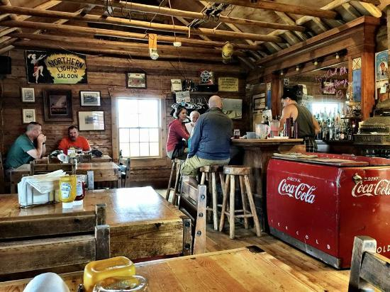 Northern Lights Saloon and Cafe: Built in 1912 as a cabin, this is now the dining room. Orginal cash register is on the far right