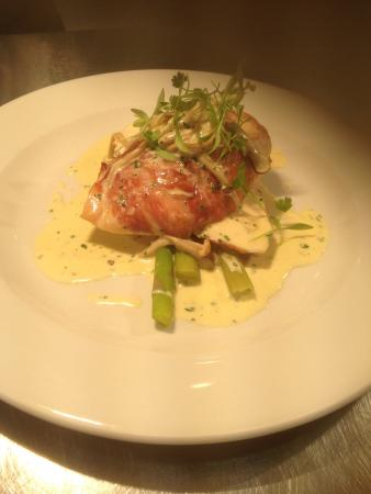 The Cross Keys Restaurant Stow: Chicken breast wrapped in Parma ham on a bed of asparagus along with white wine mushroom sauce