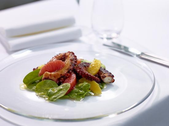 The Pottinger Hong Kong : Grilled Mediterranean octopus and citrus salad on a bed of hand-picked baby spinach leave