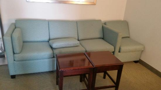 SpringHill Suites Houston Katy Mills: Mismatched and scared furniture