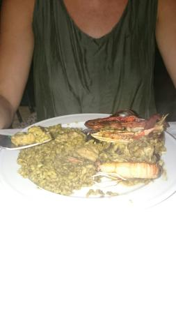 Restaurante Ca Na Ribes : Seafood and fish paella.26 euros for two. Lovely food and friendly staff.