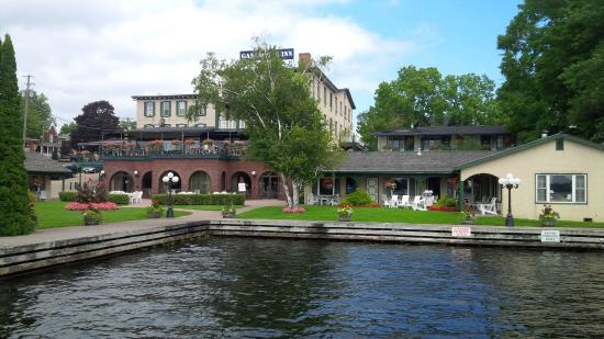 Watermark Restaurant at The Gananoque Inn: Gananoque Inn from the boat dock, showing open-air restaurant patio on 2nd level