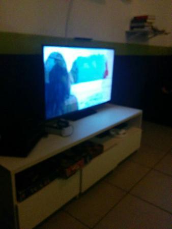 Okupe Hostel Jardins: tv gigante para assistir varios programas