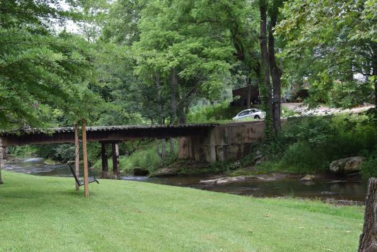 View from cabin bridge to adjoining farm picture of for Mountain springs cabins asheville nc