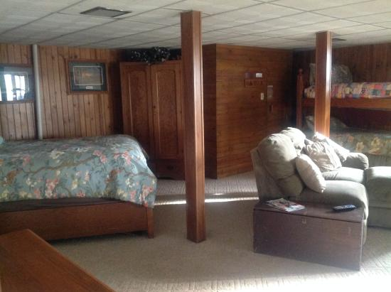 Creston, IA: Large bedroom with queen bed, bunk beds, fireplace and tv.