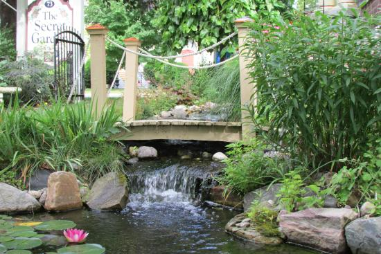 Secret Garden Bed & Breakfast Inn: The babbling brook heading to the koi pond