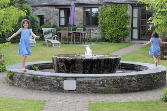 Tredethick Farm Cottages: playing in the fountain