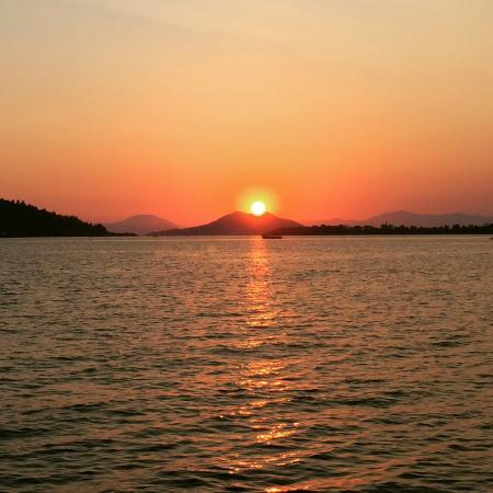 Denizati: Sunset by the water