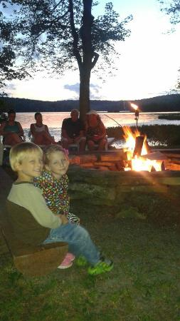 Central House Family Resort: Campfire with lake in background in the evening