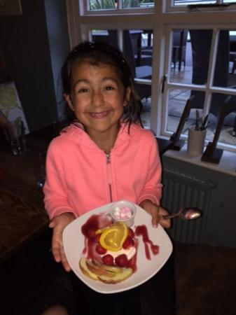 Globe Inn: My very happy little girl (who had already dipped her finger in the coulis). Thank you Carol!