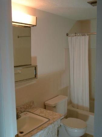 Avalon Corporate Suites: Your bath provides privacy, a tub and shower, and dressing area.