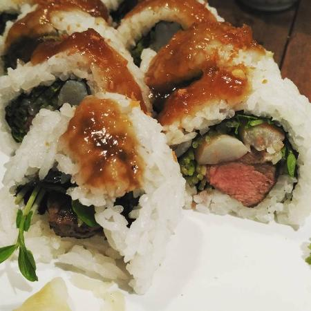 Mr Munchies: Grilled steak with steamed prawn sushi, drizzled in sweet onion sauce.
