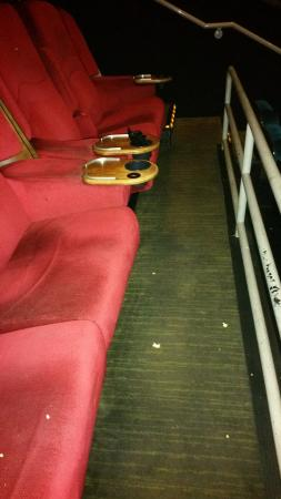 iPic Theaters: Never cleaned from the last movie. Popcorn on floor, seats and cup holder full of garbage