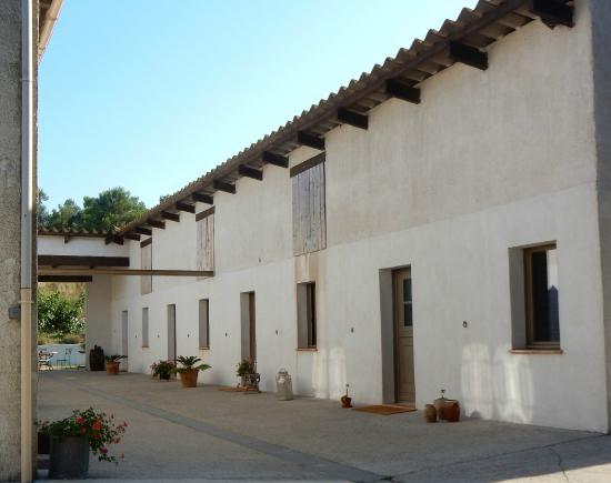 Le Relais de la Cavayère : The well converted stable block which houses the bedrooms.