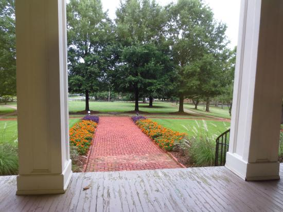 View Of The Grounds Looking Past The Front Porch Columns Picture Of Arlington Antebellum Home