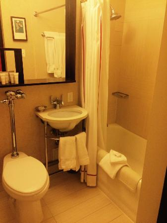 Small bathroom included sliding door which was not accommodating.