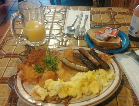 Moulin Rouge Restaurant: Orange juice, potato hash, scrambled eggs, sausages, and toast.  Mmm-mmm.