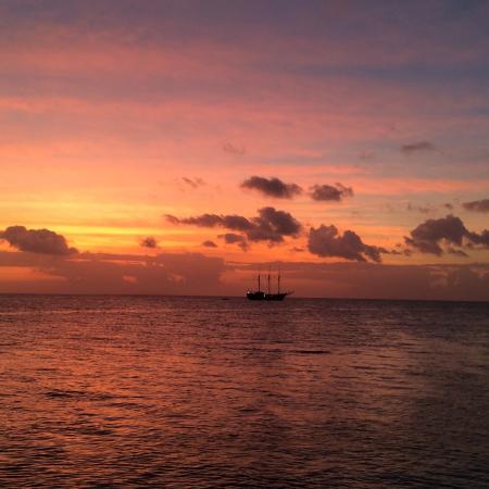 Wakatobi Dive Resort: Sunset from the jetty bar