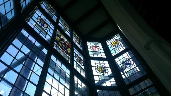 The Dining Rooms at Cinema City: A selection of stained glass windows opposite the bar