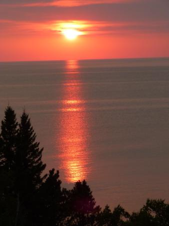 Ahmeek, MI: Romantic sunset from the tower wrapped in each other's arms.